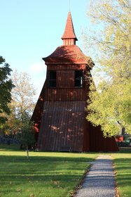 Wooden church bell tower in autumn sunlight