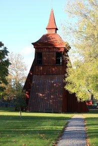 Wooden church bell tower in autumn sunlight