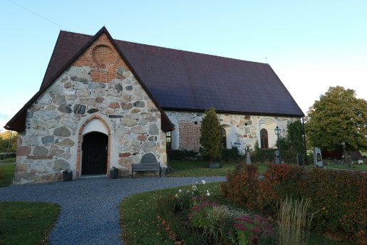 Medieval stone church, sideview with entrance