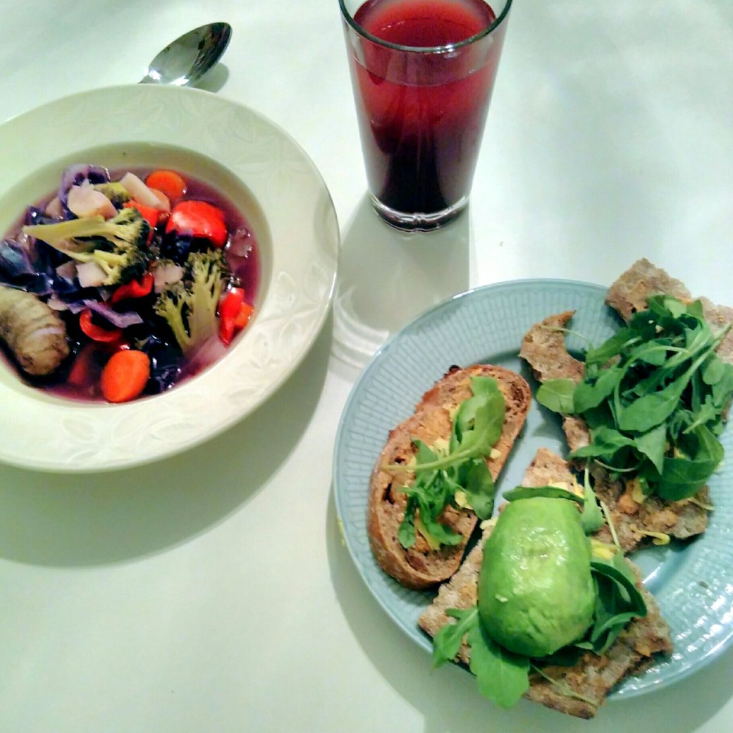 plant-based vegan dinner: rich vegetable soup, bread with peanut butter, rucola and avocado. Blueberry juice diluted with water, 1:5